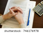 hand on a document with... | Shutterstock . vector #746176978
