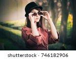 beautiful girl drinking coffee... | Shutterstock . vector #746182906