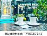outside cafe table with two... | Shutterstock . vector #746187148