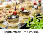 assorted canapes on table...   Shutterstock . vector #746190106