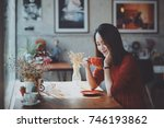 asian woman drinking coffee in... | Shutterstock . vector #746193862
