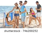young people having party on... | Shutterstock . vector #746200252