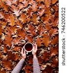 floral autumn background. a mug ... | Shutterstock . vector #746200522