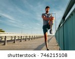 young man warming up before his ... | Shutterstock . vector #746215108