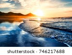 amazing beach sunset with... | Shutterstock . vector #746217688