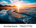 amazing beach sunset with... | Shutterstock . vector #746217742