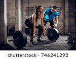 young woman exercising at the... | Shutterstock . vector #746241292