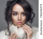 fashion studio portrait of... | Shutterstock . vector #746246575