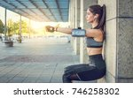 young sportswoman doing squats... | Shutterstock . vector #746258302