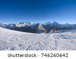 a lone mountaineer walking down ... | Shutterstock . vector #746260642