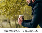 side view of smiling young man... | Shutterstock . vector #746282065
