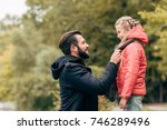 side view of happy father and... | Shutterstock . vector #746289496