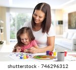 mother and daughter together... | Shutterstock . vector #746296312