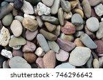 river stones background | Shutterstock . vector #746296642
