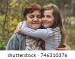 grandmother and granddaughter... | Shutterstock . vector #746310376