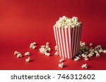 striped box with popcorn on red ... | Shutterstock . vector #746312602