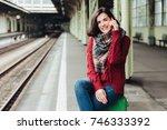 beautiful brunette female wears ... | Shutterstock . vector #746333392