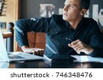 business man seriously looking... | Shutterstock . vector #746348476