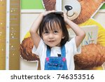 cute asian little girl is... | Shutterstock . vector #746353516
