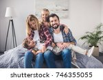 happy parents and kids sitting... | Shutterstock . vector #746355055