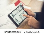 real estate agent or architect... | Shutterstock . vector #746370616