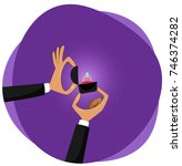 man is holding in hand an open... | Shutterstock .eps vector #746374282