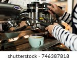 young owner or pretty barista... | Shutterstock . vector #746387818