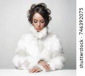fashion studio portrait of... | Shutterstock . vector #746392075