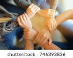 team teamwork join hands... | Shutterstock . vector #746393836