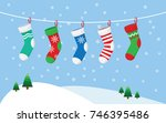 christmas stockings for... | Shutterstock .eps vector #746395486