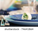 Blue table setting for romantic dinner with rose. - stock photo
