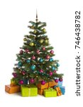 wrapped gifts below illuminated ... | Shutterstock . vector #746438782