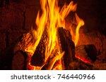a fire burns in a fireplace ... | Shutterstock . vector #746440966