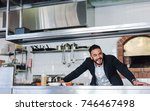 happy young restaurant owner... | Shutterstock . vector #746467498