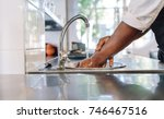 close up of chef washing his... | Shutterstock . vector #746467516