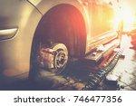 car in garage in auto mechanic... | Shutterstock . vector #746477356