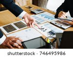 group of businesspeople... | Shutterstock . vector #746495986