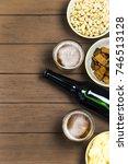 dark beer in a bottle and light ... | Shutterstock . vector #746513128