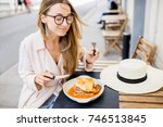 woman eating traditional... | Shutterstock . vector #746513845