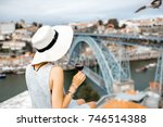 young woman tourist sitting... | Shutterstock . vector #746514388