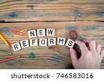 new reforms. wooden letters on... | Shutterstock . vector #746583016