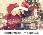 happy couple with christmas... | Shutterstock . vector #746585866
