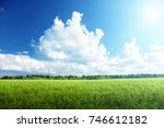 field of grass and perfect sky   Shutterstock . vector #746612182
