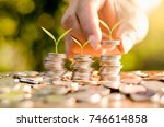coins are stacked and seedlings ... | Shutterstock . vector #746614858