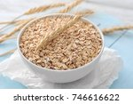 bowl with raw oatmeal on table | Shutterstock . vector #746616622