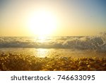pebble beach in the summer and... | Shutterstock . vector #746633095