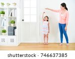 pretty attractive mother with... | Shutterstock . vector #746637385