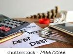 focus on debt word on white... | Shutterstock . vector #746672266