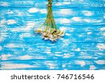 a bouquet of chamomile lies on... | Shutterstock . vector #746716546