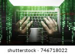 hacker at work on laptop...   Shutterstock . vector #746718022